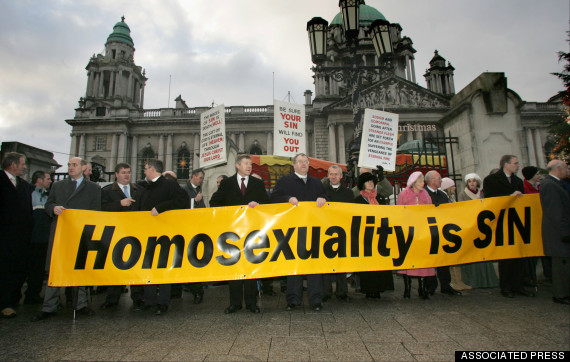 Anti gay wedding protesters protest outside Belfast City Hall, Northern Ireland, Monday, Dec. 19, 2005, where the first set of civil partnership ceremonies for gay couples in the the United Kingdom, two women, Shannon Sickles and Grainne Close, exchanged vows. Another lesbian couple and a gay couple will also exchange vows Monday.  (AP Photo/Peter Morrison)